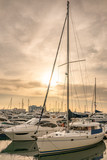 The marine jetty with yachts and boats in the light of sunset - 248041098