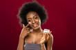 Positive nice young woman using organic cream