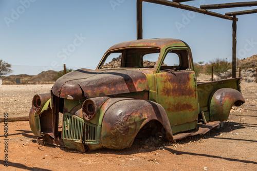 fototapeta na ścianę Abandoned vehicle wrecks in the desert of Namibia, Africa