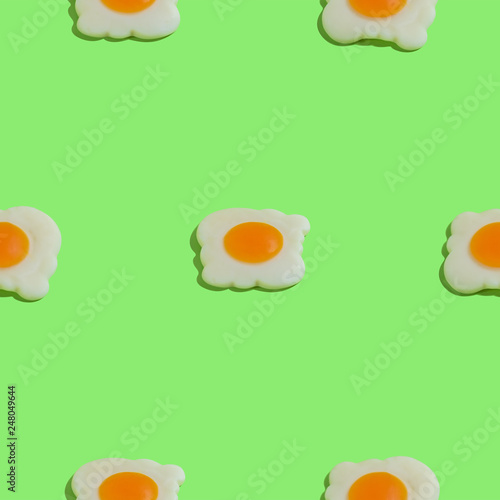 Leinwandbild Motiv Creative seamless pattern with scrambled eggs on green background. Food abstract background