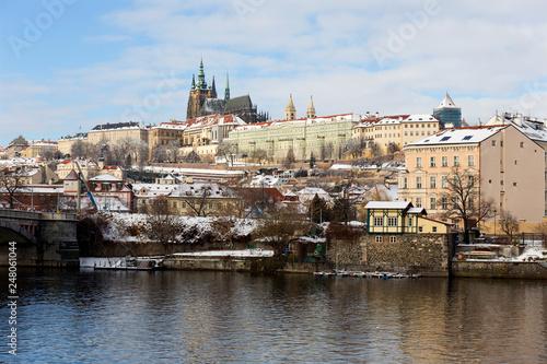 fototapeta na ścianę Snowy Prague Lesser Town with Prague Castle above River Vltava, Czech republic