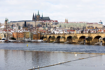 Snowy Prague Lesser Town with Prague Castle and Charles Bridge, Czech republic