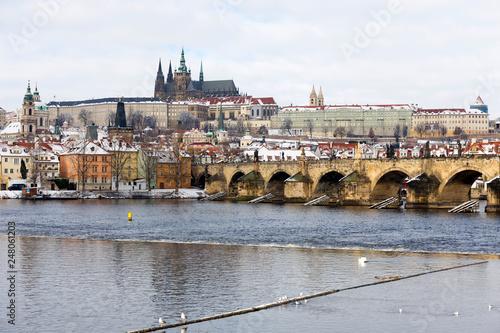 Snowy Prague Lesser Town with Prague Castle and Charles Bridge, Czech republic - 248061203