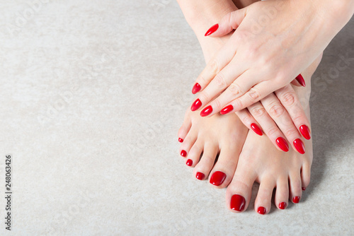 Young lady is showing her red manicure nails - 248063426
