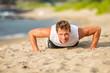 Leinwanddruck Bild - Fit man athlete training hard doing push-ups on beach. Fitness motivation.