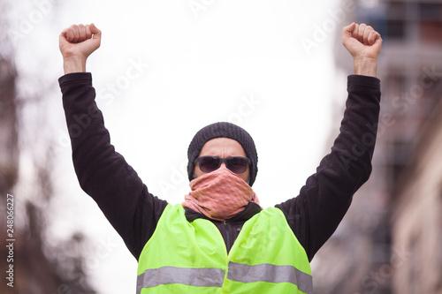 Leinwandbild Motiv yellow vest protester on the street