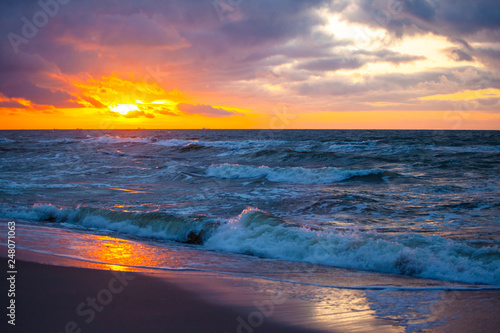 beautiful sunset view over the sea with bright colorful clouds