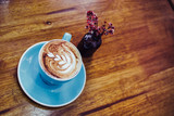 Cappuccino cup on the table in vintage coffee shop. Simple Living Lifestyle. - 248086440