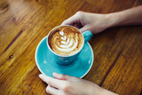 Woman hold coffee cup in her hands in vintage coffee shop. - 248086460