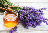 Jar with honey and fresh lavender