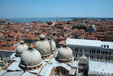 Different panoramic views of Venice from the tower bell