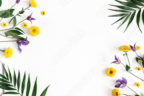 Flowers composition. Yellow and purple flowers on white background. Spring, easter concept. Flat lay, top view, copy space © Flaffy