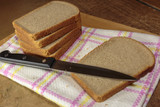 Slices of bread on wooden board.