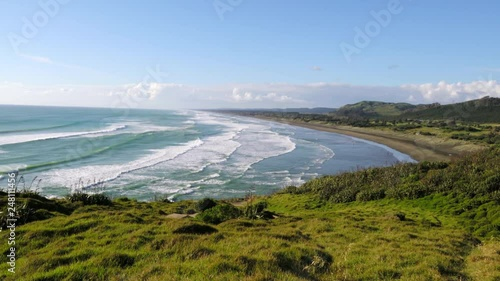 Scenic view of calm ocean waves hitting coast of island with lush greenery on sunny summer day