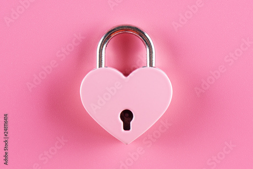 The lock in the form of a heart on a pink background - 248116414