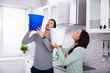 Quadro Couple Collecting Water Leaking From Ceiling In Bucket