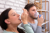 Couple Using Asthma Inhaler
