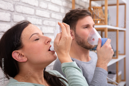 Fototapeta Couple Using Asthma Inhaler