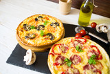 Mushroom and vegetable pizza and salami pizza at back - 248122428
