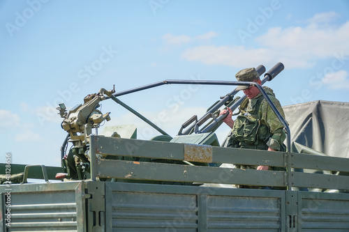 Double-barreled anti-aircraft gun in the back of car © pro2audio