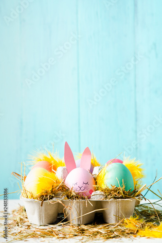 Leinwanddruck Bild Cute easter eggs composition with copy space