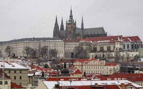 fototapeta na ścianę Romantic Snowy Prague gothic Castle with the Charles Bridge, Czech Republic