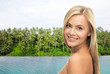 travel, tourism and summer vacation concept - beautiful woman over infinity edge pool and palms in sri lanka background