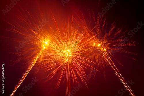 Foto Murales Fireworks in the sky at night as a background