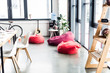 modern design of spacious loft office with bean bag chairs, wooden rack and table