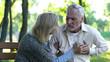 Leinwandbild Motiv Sad retired man feeling heart pain, cardio problems, wife supporting husband