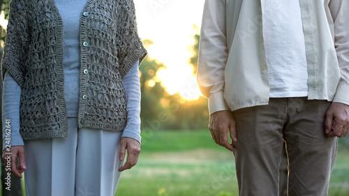 Leinwandbild Motiv Senior couple standing apart, medical insurance of elderly people, opinion poll