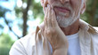 Leinwanddruck Bild - Senior man having problem with teeth, social program of dental prosthetics