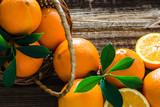 Fresh oranges on table. Organic orange fruit on wooden background
