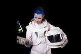 Astronaut on a black background, a young woman with face art in the space suit. - 248199071