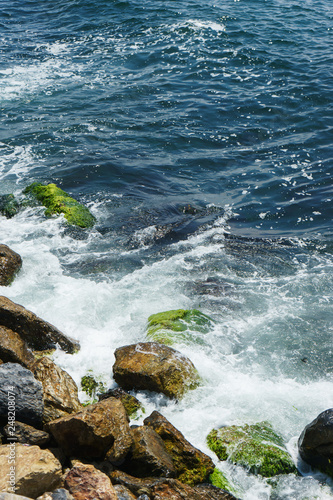 Foto Murales Sea background waves and rocks.