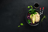 Rice with avocado and cabbage. Healthy food. Top view. On a black background. Free copy space.