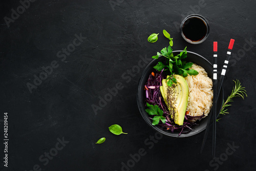 Rice with avocado and cabbage. Healthy food. Top view. On a black background. Free copy space. - 248209454