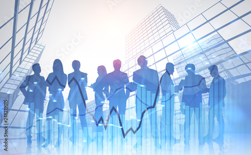 Leinwandbild Motiv Business team near skyscrapers, graph