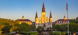 St. Louis Cathedral in Jackson Square within the French Quarter of New Orleans, Louisiana, USA. Golden morning light bathes the cathedral, American flag on right side of church, no people. Horizontal. - 248219630