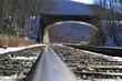 railroad tracks under bridge