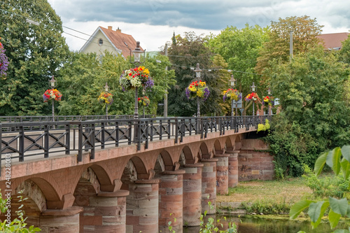 Rastatt, Germany – bridge over the river decorated with flowers. - 248228083