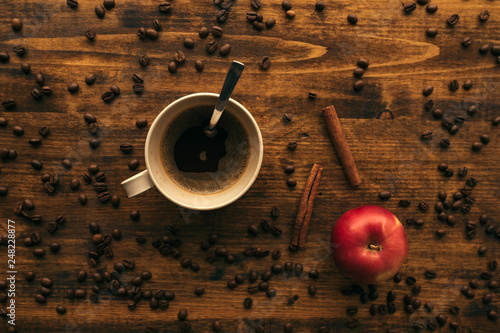 Coffee cup, cinnamon and apple, top view © Bits and Splits