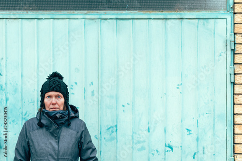 Street portrait of beautiful adult woman in urban surrounding