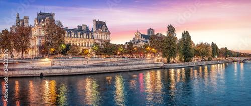 Beautiful colors near Hotel de Ville at dusk with Seine river - Paris, France. Coral color sky. - 248233296