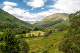 View of the Glenfinnan Viaduct from the lake to the mountains in Scotland - 248236802