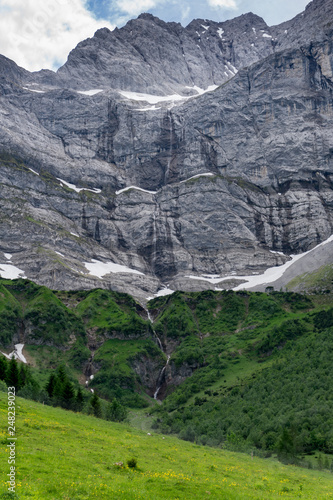 Small waterfall in the Alps (vertical) - 248239023