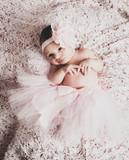 Newborn baby girl wearing a pink ballerina tutu