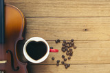 cup ofcoffee and violin on wooden