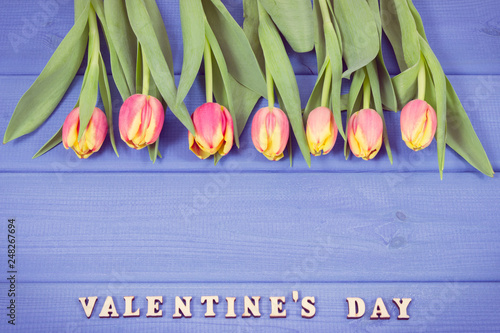 Fresh tulips for Valentines Day, copy space for text on boards. Vintage photo