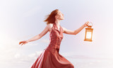 Attractive girl muse with old lantern in hand at summer day - 248286810